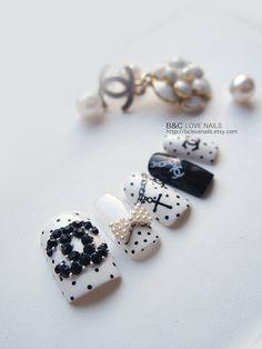 Coco Chanel fake nails