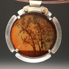 "Niss Kubly: 'Trees, Prescott, AZ' Necklace in copper, vitreous enamel, sterling silver, brass, and stainless steel neckwire. Pendant measures 1.5"" in diameter."