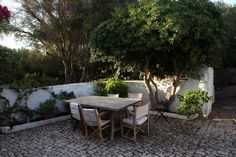 The outdoor eating area. Flower beds are edged with mares, a local limestone. It is naturally white and blends in with old building stone, which is white-washed.