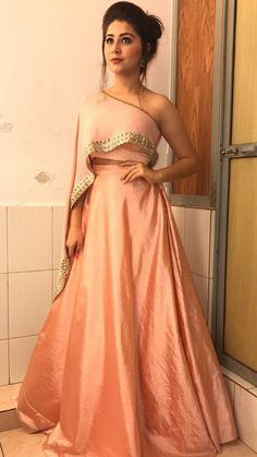 The Stylish And Elegant Lehenga Choli In Peach Colour Looks Stunning And Gorgeous With Trendy And Fashionable Embroidery .The Art Silk Fabric Party Wear Lehenga Choli Looks Extremely Attractive An. Gown Dress Party Wear, Party Wear Indian Dresses, Indian Wedding Gowns, Designer Party Wear Dresses, Indian Gowns Dresses, Party Wear Lehenga, Indian Fashion Dresses, Dress Indian Style, Indian Designer Outfits
