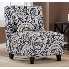Pack tons of style in a small space with this high-impact upholstered accent chair.  A sleek armless profile contrasts with a bold print in tan and navy and includes weld cord detail on the seat and back, tradition button tufting, and a matching pillow.