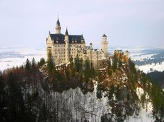 Neuschwanstein Castle is a 19th-century Romanesque Revival palace on a rugged hill above the village of Hohenschwangau near Füssen in southwest Bavaria, Germany.  Photo credit - Narendran Vaideeswaran 2006