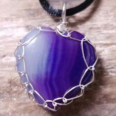 Silver non-tarnish Viking Knit wrapped purple agate heart pendant on black rope necklace. Doesn't it look like purple rain?