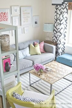 Idea for living room, add a bench along the wall and move sofa table back behind the couch