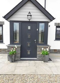 Ideas House Front Modern Ideas House Front Modern Porches houseAnthracite composite front door and Marley Cedral cladding in light grey on new .Anthracite composite front door and Marley Cedral cladding in light grey Porch Uk, Front Door Porch, Grey Front Doors, Porch Doors, Front Porch Design, House Front Door, House With Porch, House Entrance, Porch On Bungalow