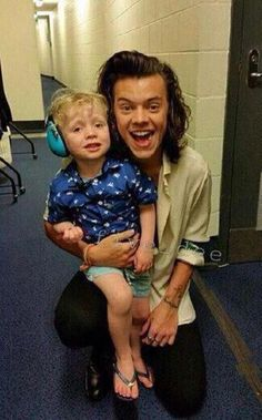 DONT GIVE HIM CHILDREN<<<< Imagine him as a dad though, taking his child to a concert, checking up on him whenever he can to make sure he's okay and having fun :)