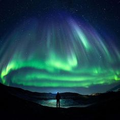 """""""Ilulissat gave us the traditional green welcome tonight."""" Photo by Paul Zizka…"""