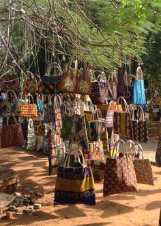 Hand-woven purses at the open-air Maputo market in Mali. #africanmarkets