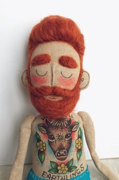 A personal favourite from my Etsy shop https://www.etsy.com/listing/268836529/cloth-doll-baby-beardy-with-tattoos