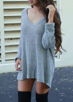 Gorgeous lightweight sweater dress features charcoal knit and v-neck cut front. Material is soft and light and very cozy. Tie it on the side to crop it and wear with jeans or a highwaisted skirt, or wear it as a sweater dress with thigh high socks or tights! Great for transitioning into spring! ...