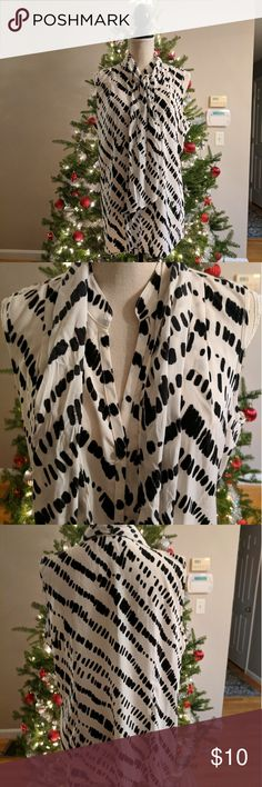 Liz Claiborne sleeveless Black & White Blouse XL Liz Claiborne black and white sleeveless blouse, size XL. 100% polyester, button-down with v-neck and a scarf that hoops through a loop on the back collar to make a bow in the front or tie it to make it a long dangling scarf . Perfect to go under your favorite cardigan or suit jacket. Liz Claiborne Tops Button Down Shirts