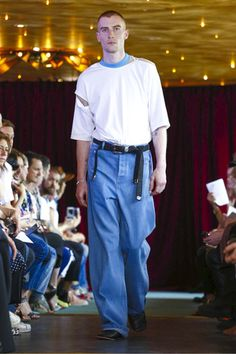 """""""Sleeves that sloped into voluminous shape and cascaded over hands; cuffs that flicked out into multiple layers, trouser kick-flares to match; the silhouette was all about the perfect slouch a..."""