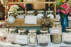 A great alternative to traditional favors are tea favors. Shown here are various mason jars filled with loose tea nestled in our B...