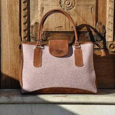 Handmade by Mayan women from Guatemala, such a beautiful bag that's made with leather and was naturally dyed organic cotton which gives the bag a very soft color. The red with the brown leather really does go great together