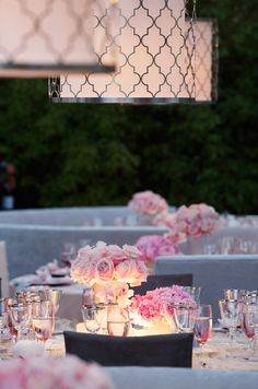 Different shades of pink flowers and lantern, so chic.