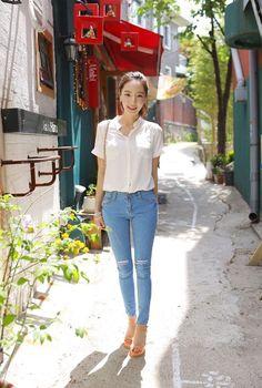 Simple. White button down shirt. Blue jeans.