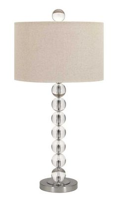 IMAX Gibson Crystal Table Lamp - Slender crystal orbs raise the bar on this table lamp, featuring a linen drum shade. Designed by Beck Fletcher.