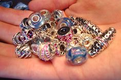 Chamilia Beads!!!! So many to choose from! Come to Diamontrigue to create your own bracelet today!