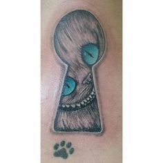 Cheshire cat tattoo looking through a keyhole by Levis Fabian....