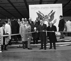 An it's show time! President Lyndon B. Johnson lends a hand cutting the ribbon to open the United States Pavilion at the start of the 1964 New York World's Fair.