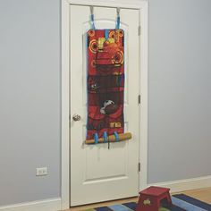 """Basketball Over The Door Organizer: Squeezed for storage in your child's bedroom? This over-the-door organizer turns unused space into a place for storage and play. Basketball-themed organizer includes eight pockets, basketball hoop, and a 23""""L drawstring net for holding balls or laundry. Either way, you score! With three hook n' look straps at the bottom for holding additional toys.. Kids Toy Shop, Toys Shop, Kids Toys, Over The Door Organizer, Organizing, Organization, Montgomery Ward, Activity Toys, Developmental Toys"""