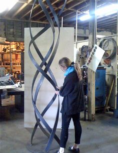 Terra Sculpture artist Jennifer Gilbert Asher works in the studio on a 10 foot version of Kismet sculpture for a client in northern California. #terrasculpture