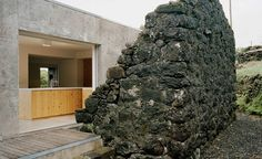 [ ARCHITECTURE ] 'Portuguese studio SAMI Arquitectos has slotted a modern concrete house behind the crumbling stone walls of a ruined building located on an island in the middle of the North Atlantic Ocean. Contemporary Architecture, Architecture Design, Contemporary Homes, Portugal, Concrete Structure, Wallpaper Magazine, Modern Coastal, Old Houses, Frames On Wall