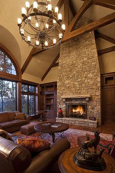 Hardwood, Exposed Beams, Rustic, Country, Built-in bookshelves/cabinets, Stone Fireplace, Chandelier, Arched Window
