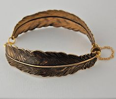 GOLD FEATHERS BRACELET by verabel