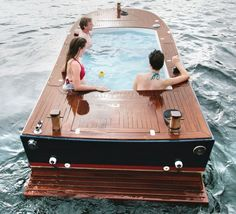 Hot tub electric boat is fitted with a waterproof stereo system and on-board chargers
