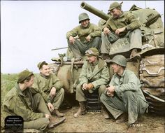 American Journalist and War Correspondent, Ernie Pyle (centre) converses with the crew of a Sherman tank belonging to 191st Tank Battalion at the Anzio Beachhead in 1944.