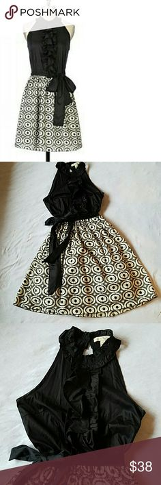 Anthropology Wesson Wear Dress size 4 EUC like new. Adorable dress with ruffles down the black front top, side zipper and button keyhole closure in the back. The eyelet skirt is fully lined and the lining has a cute net ruffle on the bottom. Skirt 80% cotton 20% polyester, top 96% cotton 4% spandex, lining 100% cotton 100% nylon. Length ca. 36 inches, skirt length ca. 21 inches, waist 28 inches. Anthropologie Dresses