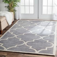 This beautifully designed Luna Moroccan Trellis Rug is h andmade with modified acrylic to prevent shedding. It w ill enhance and liven any home decor and the m oderate pile depth gives this rug a soft