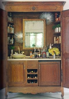 antique armoire repurposed to cocktail bar Love this idea.  Kind of like the antique court cupboard we got in England and turned into our bar.