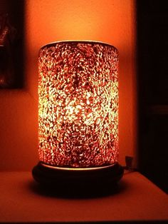 For those minimalists out there this is a beautiful way to decorate for fall without any fluff.  Simmering light with frosted orange liner, covered by our copper crackle glass shade:  simple and sophisticated decor - EZPZ!