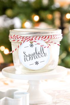 Glittery Snowball Playdough! This homemade playdough recipe is easy and great for party favors or stocking stuffers. The printable tag makes it great for neighborhood or classroom gifts too!
