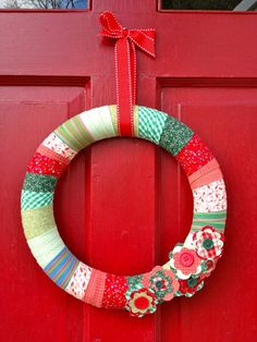 Fabric scraps in Christmas colors turn a simple wreath form into homespun decor. Get the tutorial at That's My Letter »  - GoodHousekeeping.com