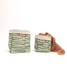 Soft Buckets by Skinny laMinx in the 'Woodpile' Design. Available in two different sizes.