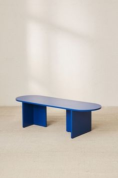 pill-shaped blue coffee table with slab legs