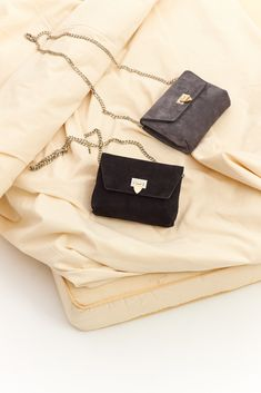 143 Cleva small pouch in suede black is a fancy bag, that can be used for everyday as well as for going out. The bag has a big compartment with three credit card slots, and it closes with an exclusive two-colored buckle in gold and silver. Going Out, Black And Grey, Campaign, Pouch, Fancy, Silver, Gold, Photos, Bags