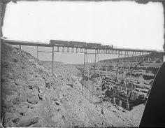 ART & ARTISTS: Powell Survey - part 2 - Santa Fe Railroad bridge over Canyon Diablo, Arizona, showing train and signs of Albuquerque, New Mexico
