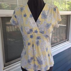 """A.N.A. Yellow Floral Tee Top A.N.A. Floral Tee Top.  Short sleeves.   Yellow floral print cotton/modal blend material.   Shoulder width 15"""".  Length 22"""".   Great condition. a.n.a Tops"""