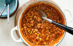 Quick, easy and delicious, this chili is perfect for a stress-free weeknight dinner. The corn adds a mildly sweet flavor to the spicy sauce. Add a can of pinto or kidney beans for extra nutrition. Lean ground turkey or beef may also be substituted for the chicken. ------1 tablespoon extra virgin olive oil *  1 large onion,  coarsely chopped * 2 cloves garlic, finely chopped * 1 1/2 tablespoon chili powder * 2 teaspoons oregano * 1 teaspoon ground cumin * 1 teaspoon ground coriander Cayenne p...