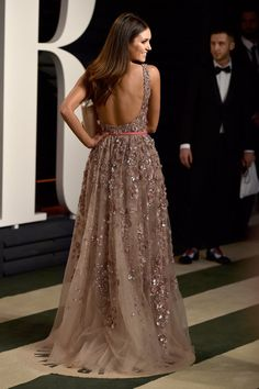 Pin for Later: 35 Oscars Looks That Are Even Better From the Back Nina Dobrev In a floral-appliqué gown.
