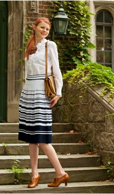 a swingy shape that falls just below the knee with box pleats in an array of broad and narrow stripes. the perfect skirt for a blustery afternoon