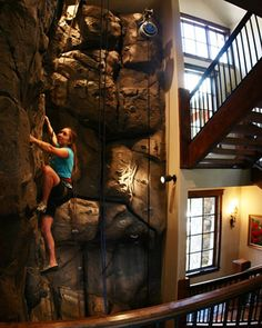 A three-story climbing wall built into the stairwell