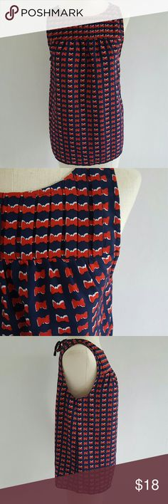 """CYNTHIA ROWLEY bow print blouse The perfect Fourth of July top featuring a red and white bow print on a blue background.  100% polyester pullover style with a tie at the neck.    12"""" shoulder to shoulder  18"""" armpit to armpit  21"""" across the bottom 27"""" Total length Cynthia Rowley Tops Blouses"""