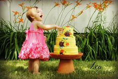 Such a cute picture of a little girl.  Birthday photo shoot ideas.  Cake smash photography pics one year old summer birthday