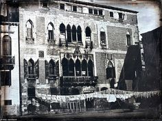 This photo shows Palazzo Gritti-Badoer with laundry hang drying on lines outside (circa 1846-1852)