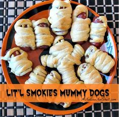 Kid-pleasing and easy to make mummy dogs are the perfect Halloween party food. Made with refrigerated crescent dough and Hillshire Farm Lit'l Smokies.  Ingredients 32 Hillshire Farm® Lit'l Smokies® 1 can (8 ounces) refrigerated crescent rolls Mustard or ketchup, if desired Directions 1.Preheat oven to 375°F. 2.Unroll dough, separate at perforations, creating 4 …